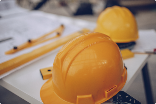 Construction hard hats on table